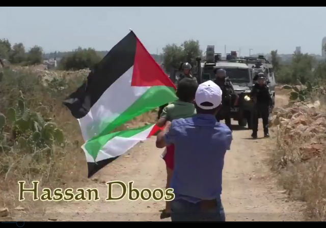 Palestinian child pushed towards soldier video screen shot